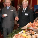 Prince Charles pointing to food